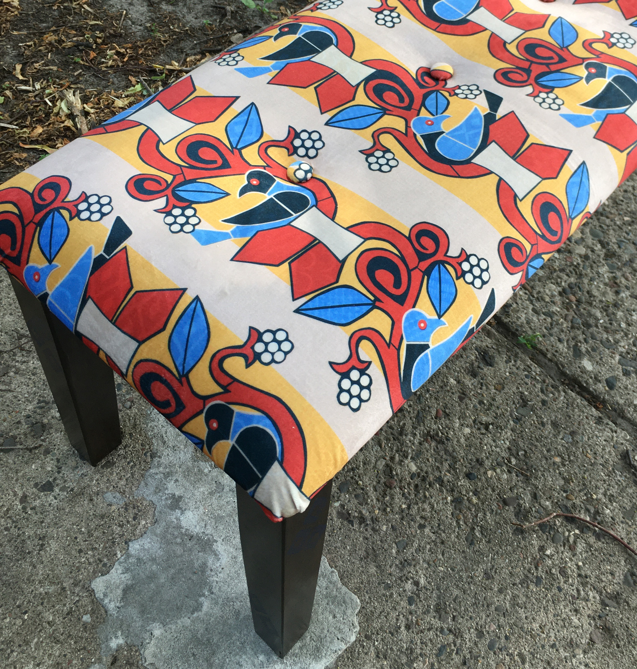 the end of an upholstered bench